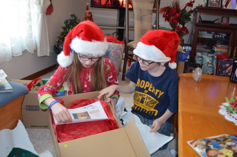 Abby & Aiden opening up Stingray Experience gift.