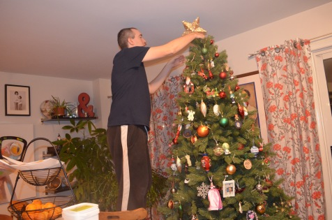 Peter putting the finishing touches on the tree.