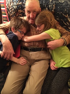 Aiden & Abby hugging their Great Uncle Joe