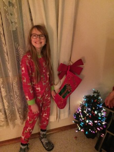 Abby hanging her stocking on Christmas Eve