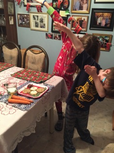 Aiden & Abby dabbing after laying out cookies & milk for Santa