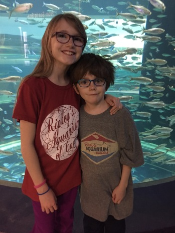 Abby & Aiden in front of their fish tanks