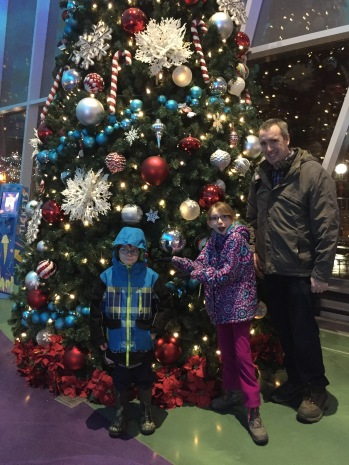 Aiden & the kids in front the Christmas Tree in the lobby