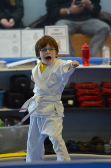 Aiden performing a lunge punch