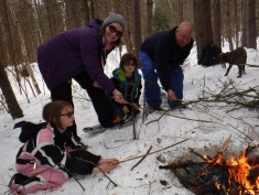 Raosting marshmallows on our snowshoeing adventure.