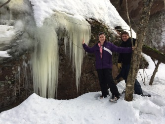 Melissa with her cousin Steven checking out ice formations along trail