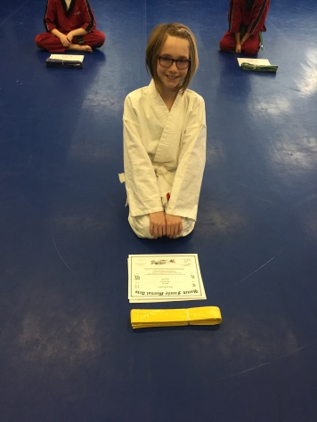 Abby with her Yellow Belt & Certificate