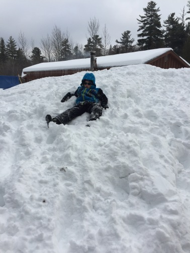 Aiden part way down the snow plow pile