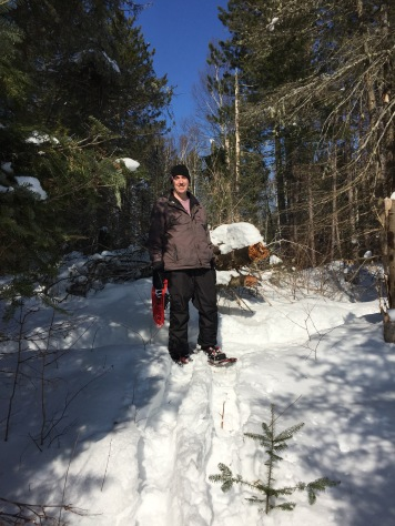 Peter on the trail carrying Aiden`s snowshoes after he decided to go without for part of the trail