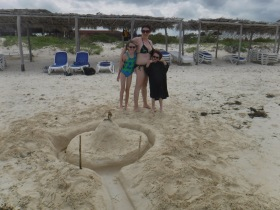 Melissa, Abby & Aiden with finished sandcastle & Moat.