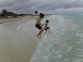Abby & Aiden playing in the Atlantic Ocean on the last day.