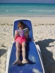 Abby reading on the beach
