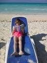 Abby reading on the beach