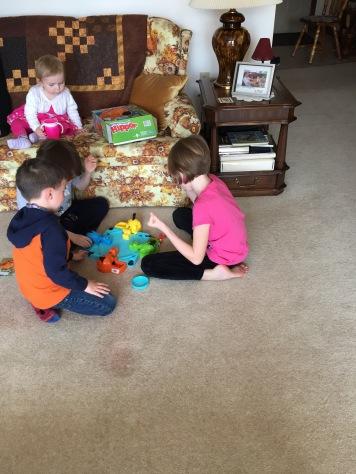Eva watching Macklan, Abby & Aiden play hungry hippo