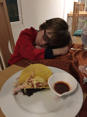 Aiden fell asleep at the table before supper arrived.