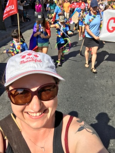 Melissa taking a selfie while marching.