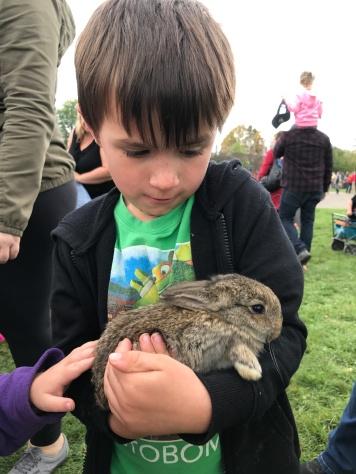 Macklan petting his rabbit