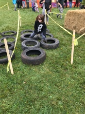 Aiden completing the obstacle course