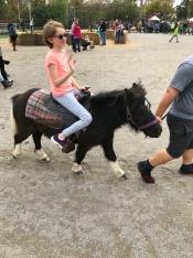 Abby riding the pony
