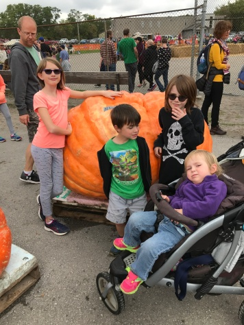 Abby, Macklan, Aiden and Eva at the largest pumpkin
