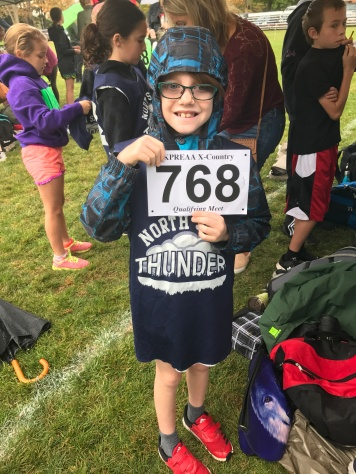 Aiden holding his number for the race.
