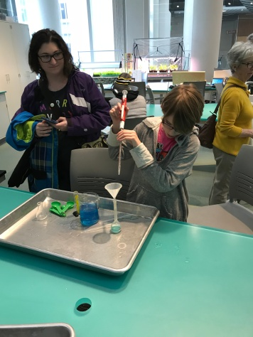 Abby conducting experiments at the Museum of Natural Sciences