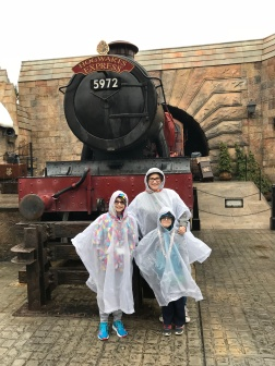 Melissa with Abby & Aiden huddling in front of the Hogwarts Express