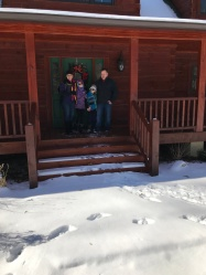 Auntie Jen, Abby & Aiden and Uncle Jason in front of their house.