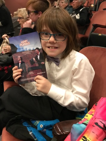 Aiden with the program waiting for the show to start