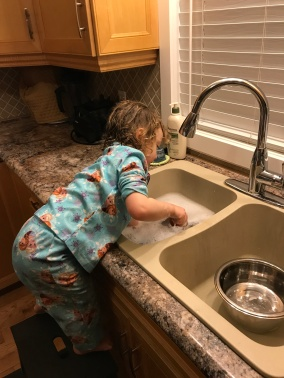 Violet doing the dishes