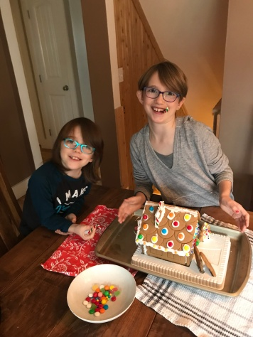 Abby & Aiden with their finished gingerbread house
