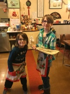 Aiden and Abby were waiting tables during the celebration.