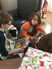 Marely & Lindy helping Abby & Aiden open presents