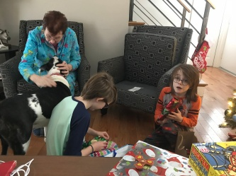 The kids opening presents while Grandma visits with Lindy