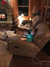 Aiden resting on the couch with the dogs