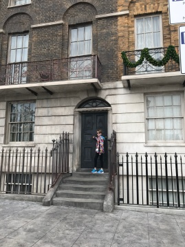 Abby in front of 12 Grimmauld Place