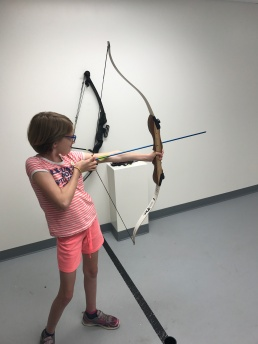 Abby shooting her bow & arrow