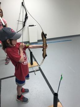 AIden shooting his bow & arrow