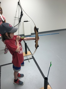AIden shooting his bow & arrow
