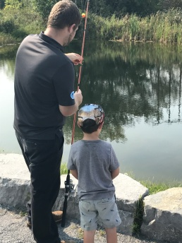 Macklan getting his fishing rod ready
