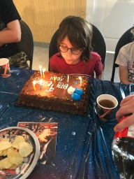AIden blowing the candles on his cake