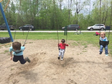 Aiden, Macklan & Eva enjoying the swings.