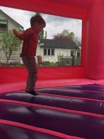 Macklan in the bouncy castle