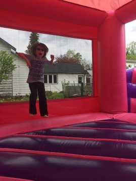 Aiden jumping in the bouncy castle