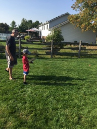 Aiden practicing casting with Dad in the backyard
