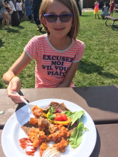 Abby with her lunch at VegFest