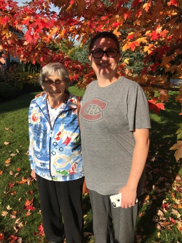 Melissa with Auntie Joyce beside the maple tree in the front yard